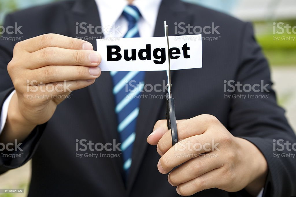 business cutting budget concept royalty-free stock photo