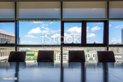 1064053478 istock photo Business data information projector board in conference room, me 1064055736