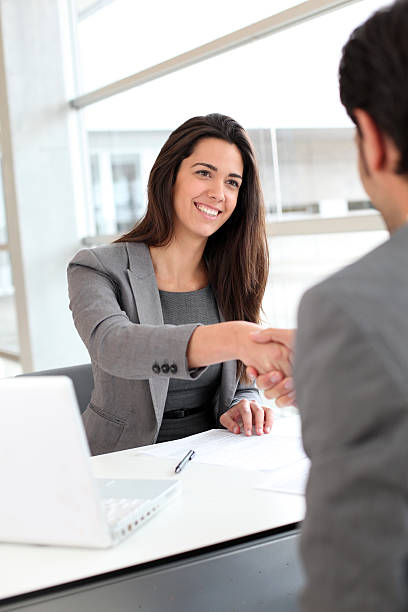 A business deal between a man and a woman stock photo