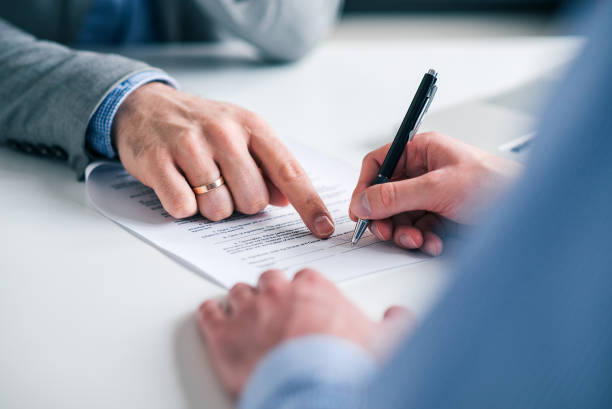 Business deal concept. Signing document, close-up. stock photo