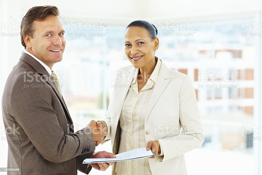 business deal - Happy executives shaking hand royalty-free stock photo