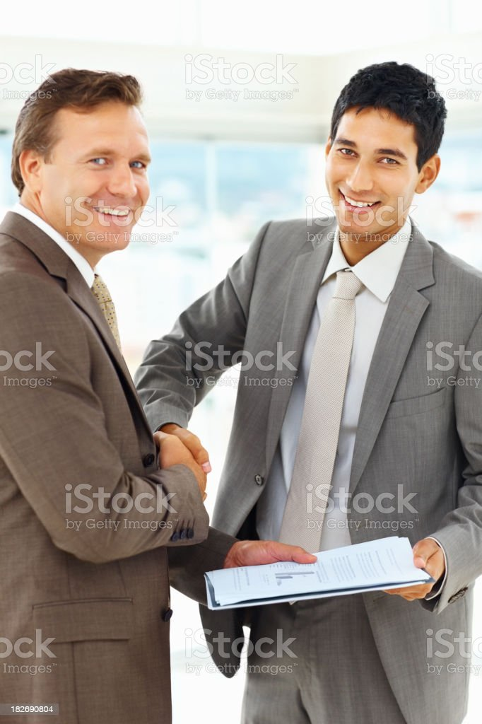 Business deal- Happy male executives shaking hands royalty-free stock photo