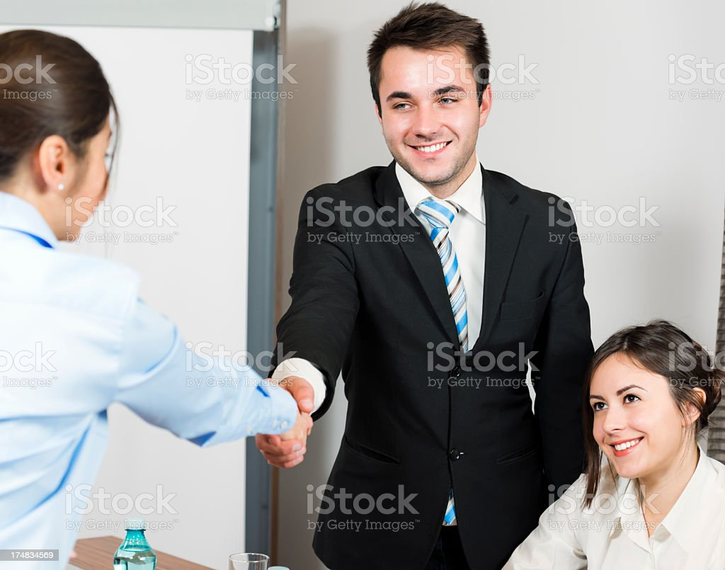 Business deal sealed with a strong handshake royalty-free stock photo