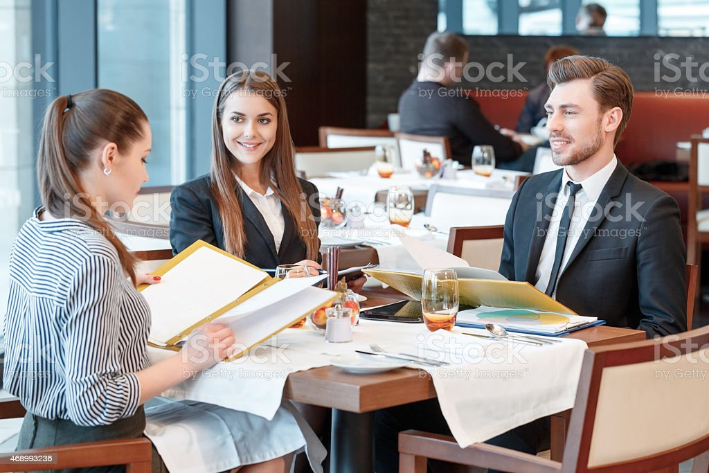 Business deals during lunch at the buffet restaurant stock photo
