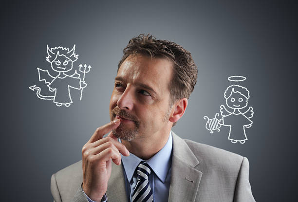 business decisions - diabolic stock pictures, royalty-free photos & images
