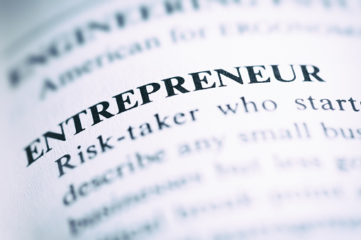 In a book of business terms, the word 'entrepreneur' is defined.