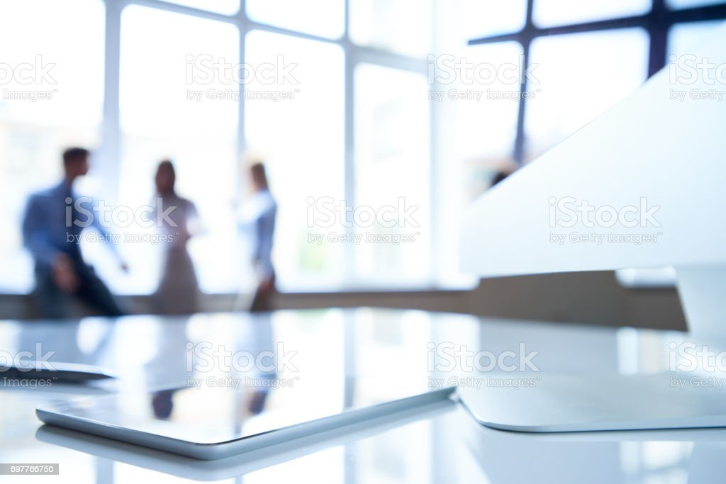 Business desk with technologies stock photo