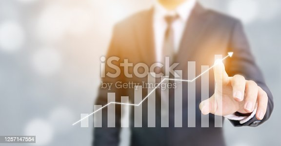 1051659174 istock photo Business development to success and growing annual revenue growth concept, Businessman pointing arrow graph corporate future growth plan 1257147554