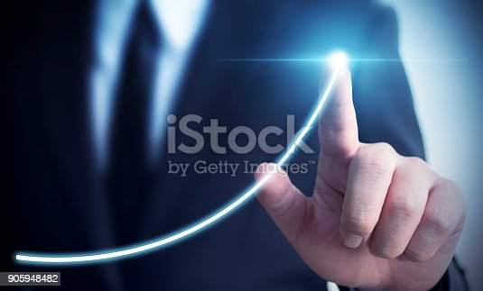 istock Business development to success and growing annual revenue growth concept, Businessman pointing arrow graph corporate future growth plan 905948482