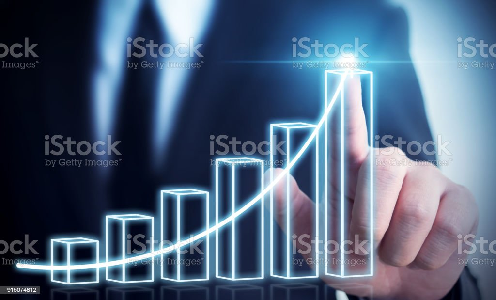 Business development to success and growing annual revenue growth concept, Businessman pointing arrow graph corporate future growth plan stock photo