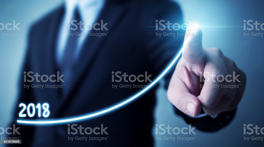 Business development to success and growing annual revenue growth 2018 concept, Businessman pointing arrow graph corporate future growth plan stock photo