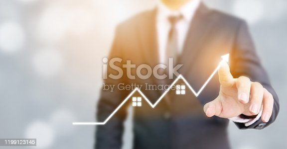 905948482istockphoto Business development to success and growing growth concept. Businessman pointing red arrow graph corporate future growth plan 1199123145