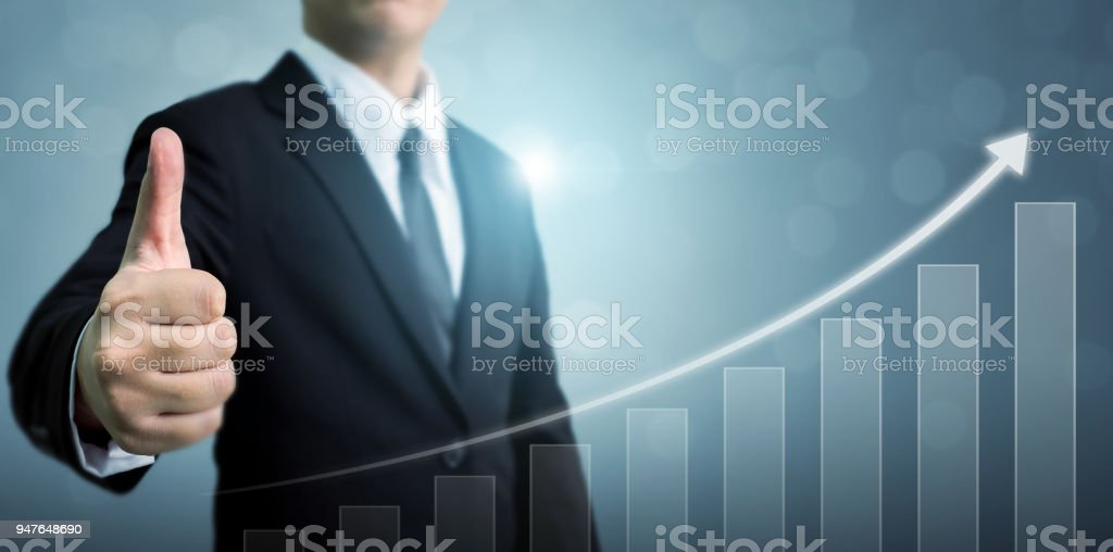 Business development to success and growing growth concept. Businessman showing OK or hand sign thumb up with arrow graph corporate future growth plan stock photo