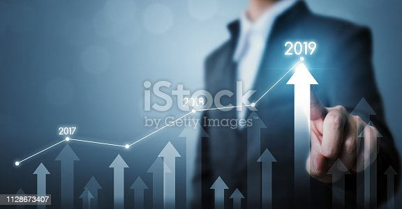 istock Business development to success and growing growth year 2019 concept, Businessman pointing line dot graph and arrow corporate future growth plan 1128673407