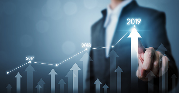 884650780 istock photo Business development to success and growing growth year 2019 concept, Businessman pointing line dot graph and arrow corporate future growth plan 1128673407