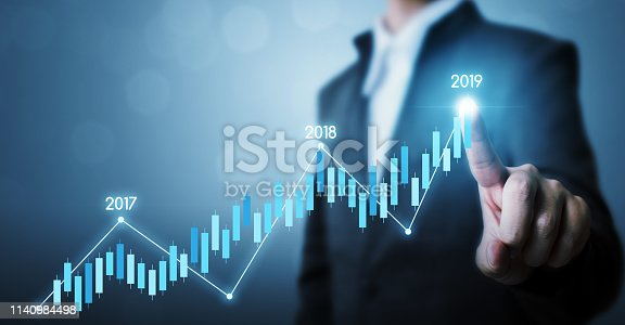 istock Business development to success and growing growth year 2019 concept, Businessman pointing line dot graph corporate future growth plan 1140984498