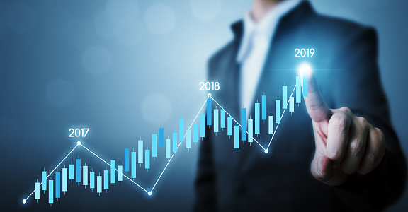 884650780 istock photo Business development to success and growing growth year 2019 concept, Businessman pointing line dot graph corporate future growth plan 1140984498