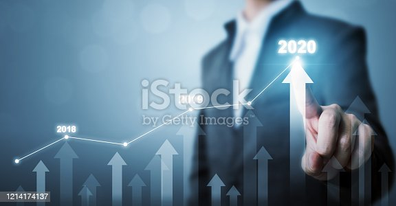 531581605 istock photo Business development to success and growing growth year 2020 concept, Businessman pointing line dot graph and arrow corporate future growth plan 1214174137