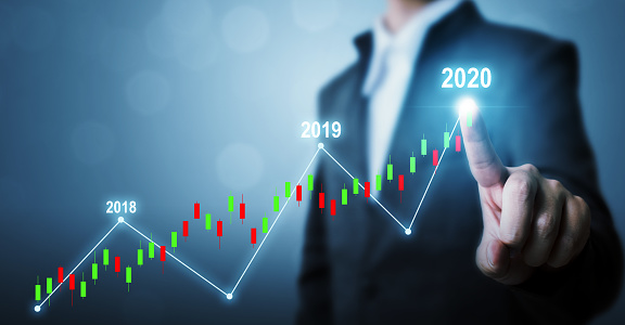 884650780 istock photo Business development to success and growing growth year 2020 concept, Businessman pointing line dot graph corporate future growth plan 1222889502