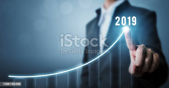 istock Business development to success in 2019 concept. Businessman pointing arrow graph corporate future growth plan 1066165486