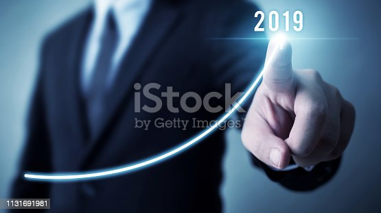 istock Business development to success in 2019 concept. Businessman pointing arrow graph corporate future growth plan 1131691981