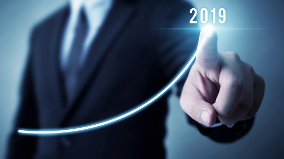 884650780 istock photo Business development to success in 2019 concept. Businessman pointing arrow graph corporate future growth plan 1131691981