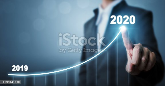 Business development to success in 2020 concept. Businessman pointing arrow graph corporate future growth plan