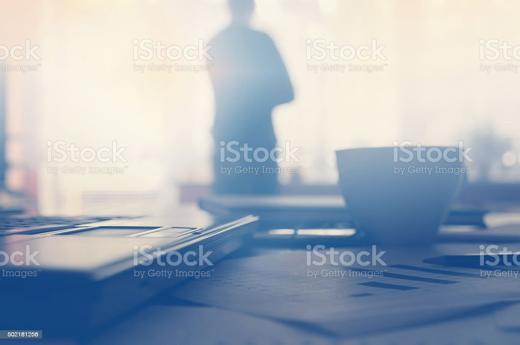 Business devices and documents at the workplace, unrecognized business people stock photo