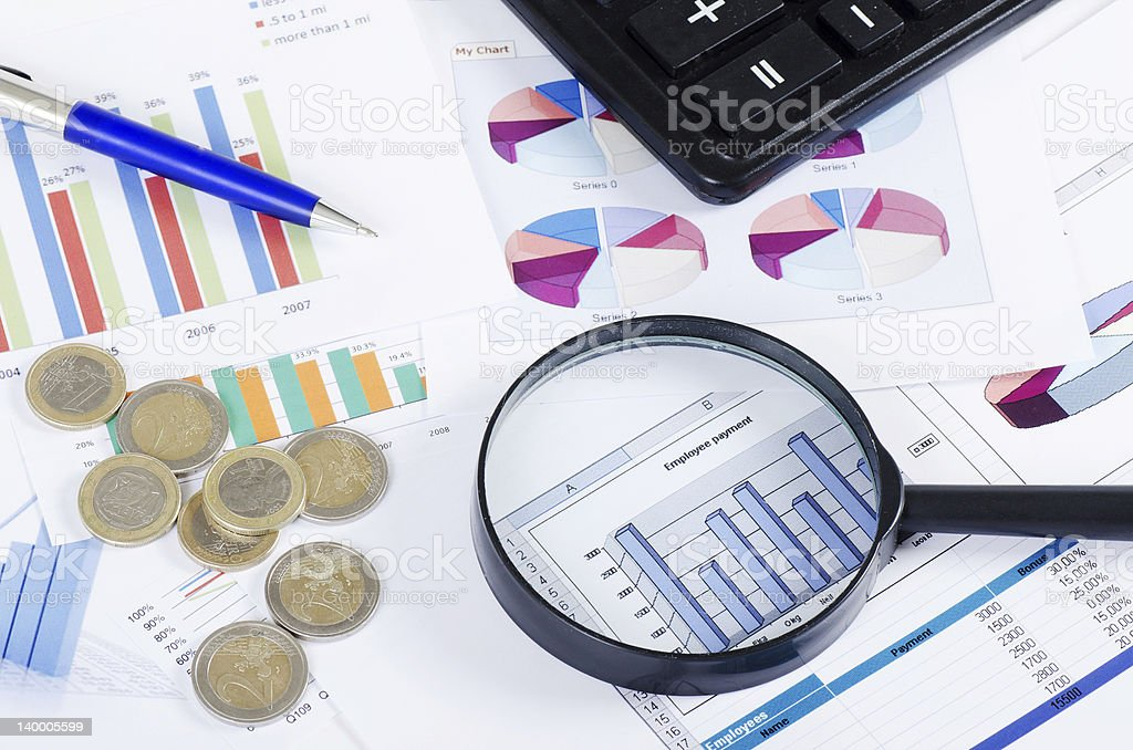 Business diagramme with magnifying glass royalty-free stock photo