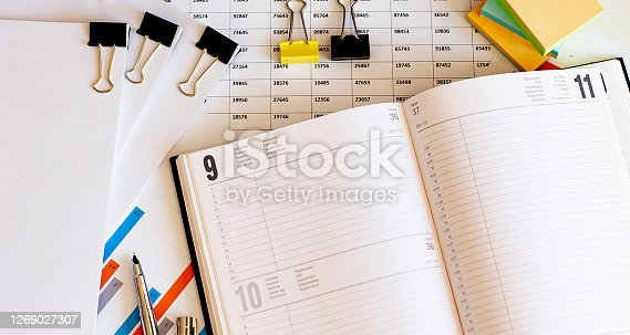 Business Diary, Calendar . Empty paper sheets with numbers and dates, chatrs, metal pen.Daily, weekly, monthly planner .