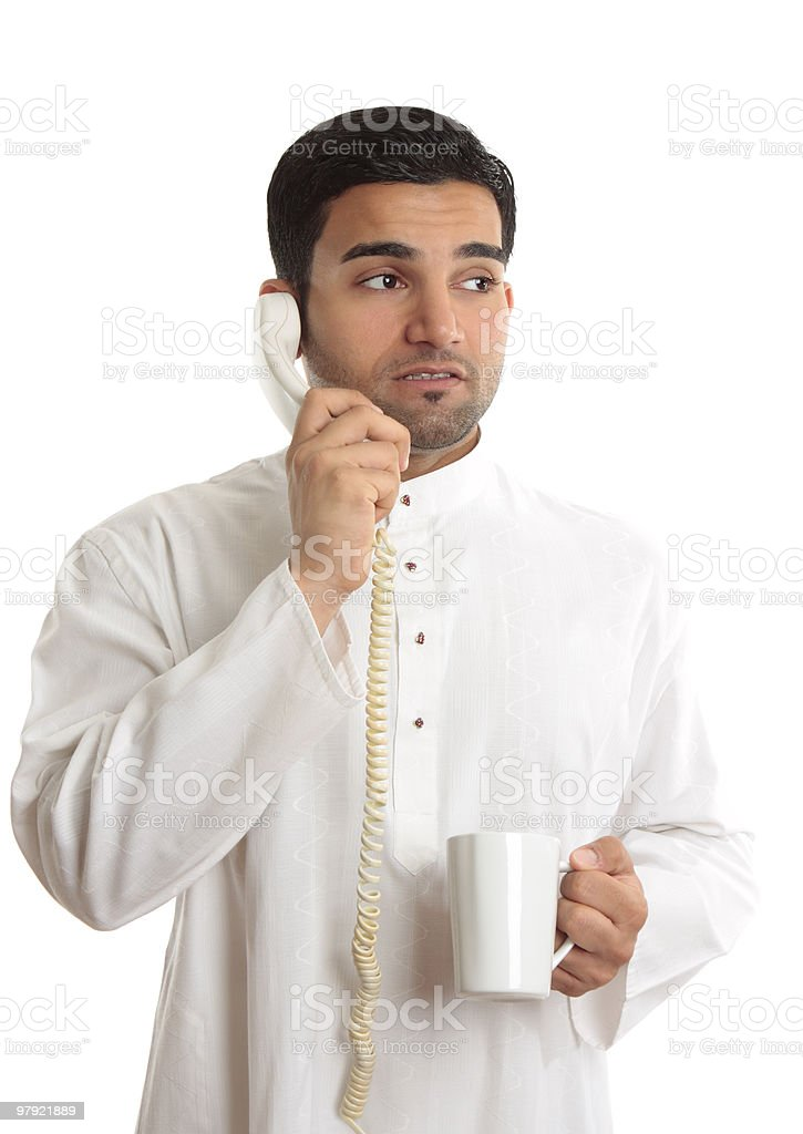 Business dilemma - worried man on phone royalty-free stock photo