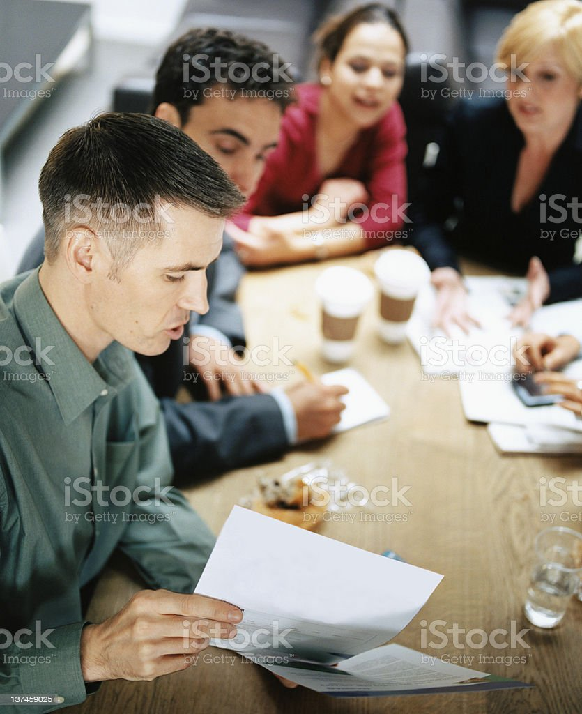 Business discussion over coffee stock photo