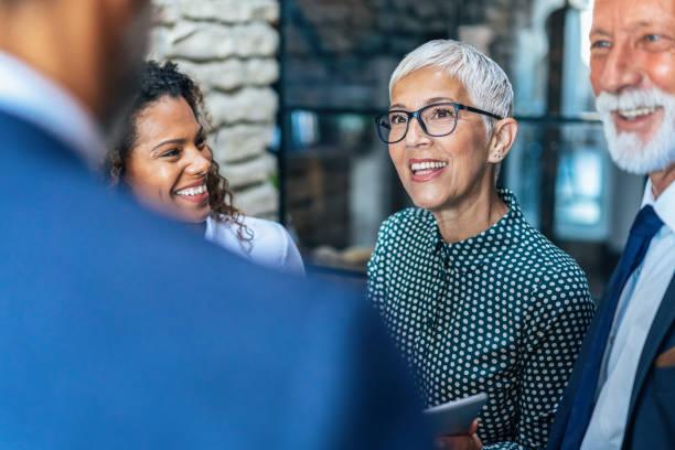 business discussion - senior business woman tablet imagens e fotografias de stock