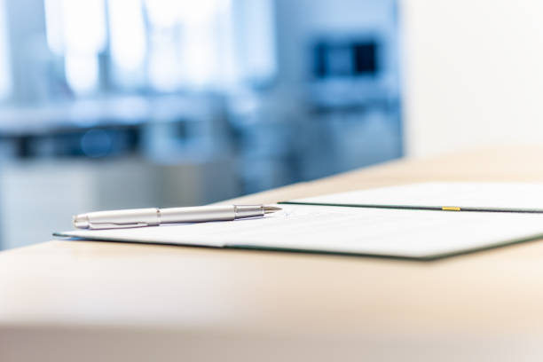 Business document in an open folder stock photo