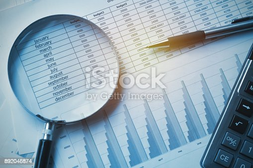 istock business documents accounting with calculator, pen and magnifying glass. concept for financial 892046874