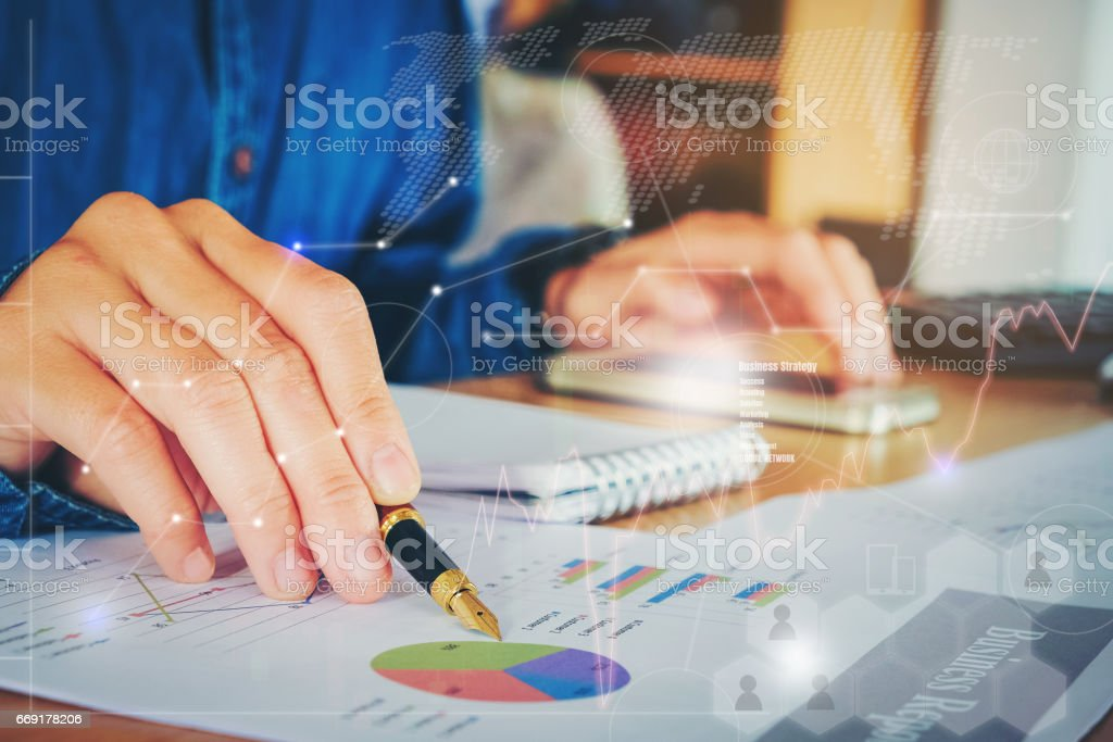 business documents on office table with smart phone  graph financial with social network diagram and man working in the background stock photo