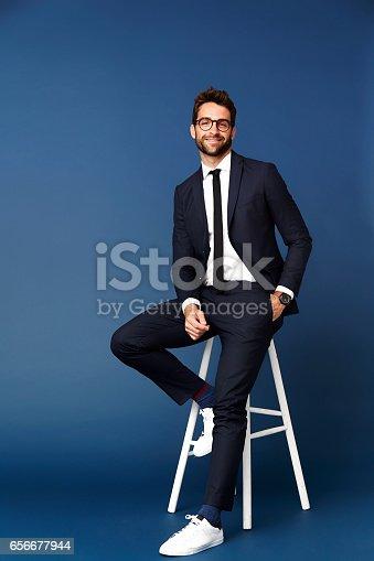 620404536istockphoto Business dude on stool 656677944