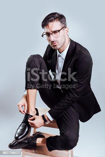 620404536istockphoto Business dude on stool 892706522