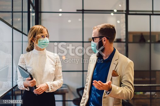 Businesspeople wearing masks in the office for safety during epidemic situation