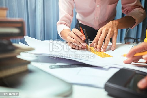 istock Business engineer contractor working at his desk table in office. 669343598