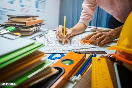 istock Business engineer contractor working at his desk table in office. 669345994