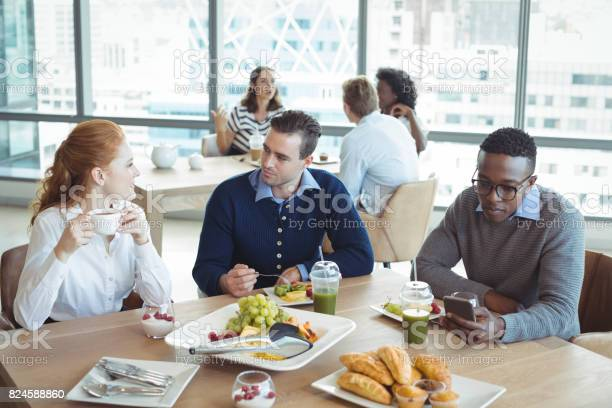 Business entrepreneurs sitting at breakfast table in office picture id824588860?b=1&k=6&m=824588860&s=612x612&h=0mf2g0ckixysowfcn6fhs2zwugy3igwcuuf3caa8fvy=