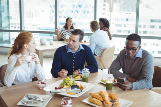 Business entrepreneurs sitting at breakfast table in office picture id824588860?b=1&k=6&m=824588860&s=612x612&w=0&h=sac2o11dwu1qr na4pqsrkolza nrkfltfi9cjcuodw=