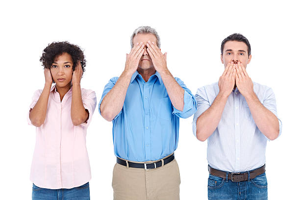 "Business ethics Three people portraying ""see no evil, speak no evil, hear no evil"" while isolated on a white hear no evil stock pictures, royalty-free photos & images"