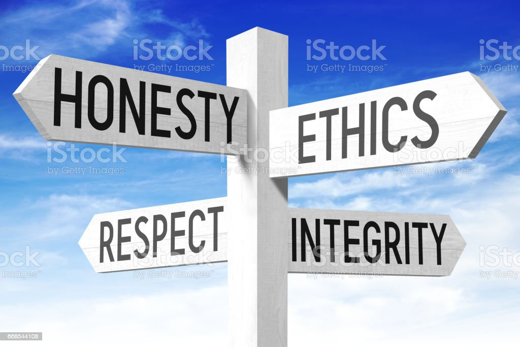 Business ethics - wooden signpost stock photo