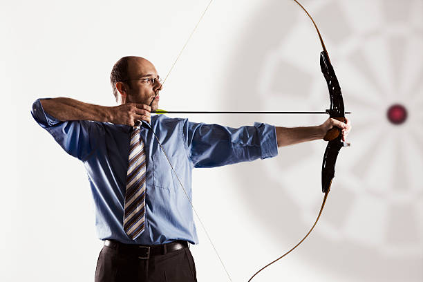 Business executive aiming at target. stock photo