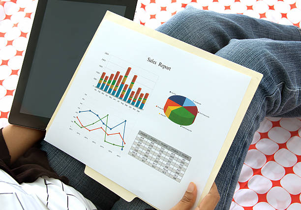Business executive analyzing corporate data and reports stock photo