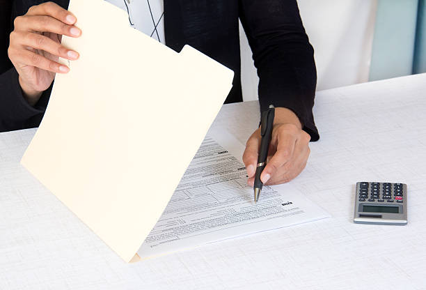 Business executive at workplace writing a document stock photo