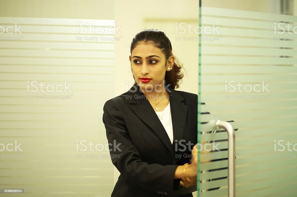 Business Executive Entering Office stock photo