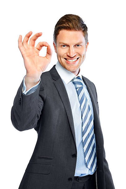 Business executive gesturing an excellent job stock photo